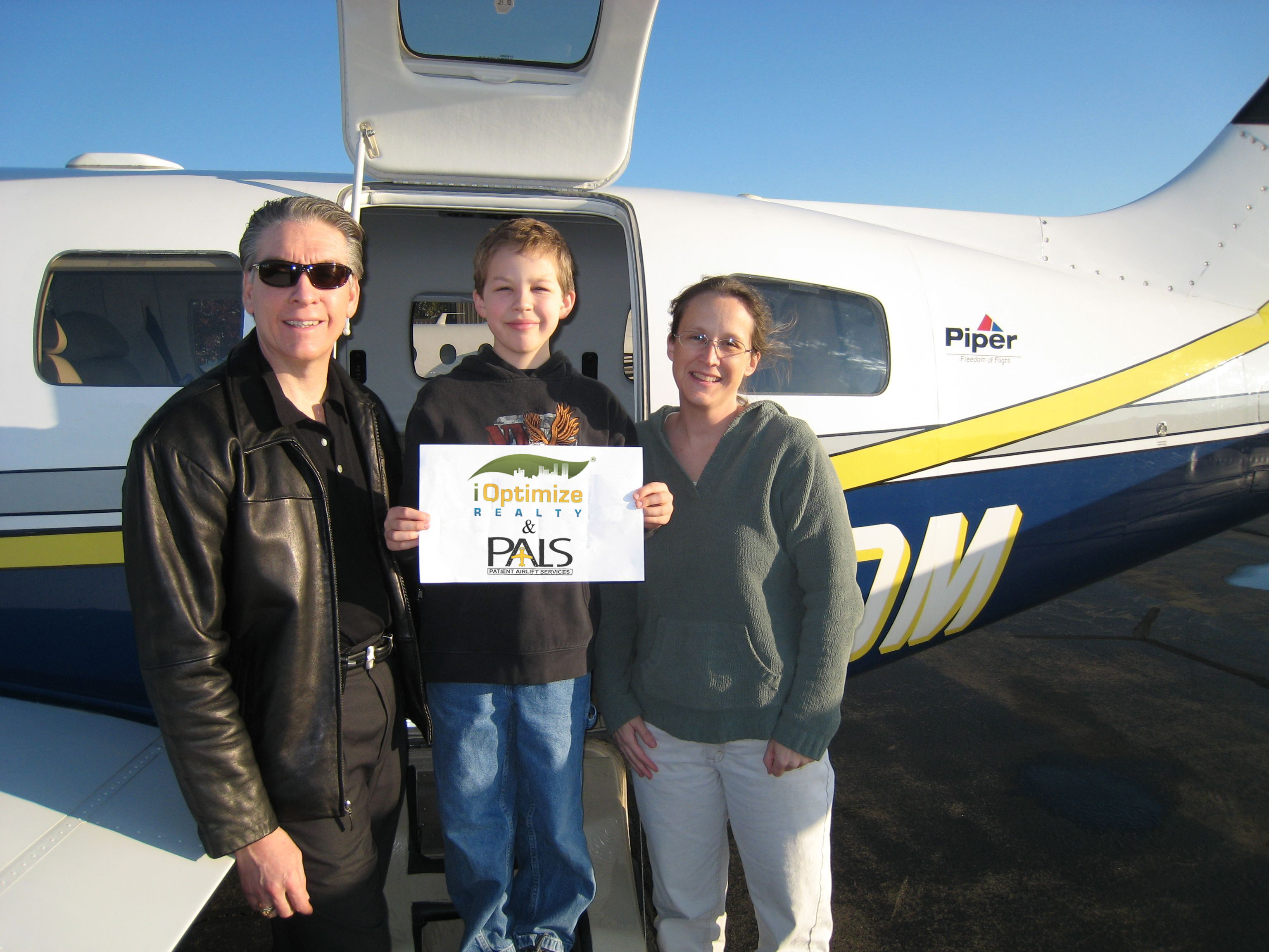 iOptimize Realty® charity flight taking 7 year old boy to treatment.